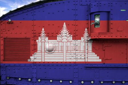 Cambodia flag depicted on side part of military armored tank close up. Army forces conceptual background Reklamní fotografie