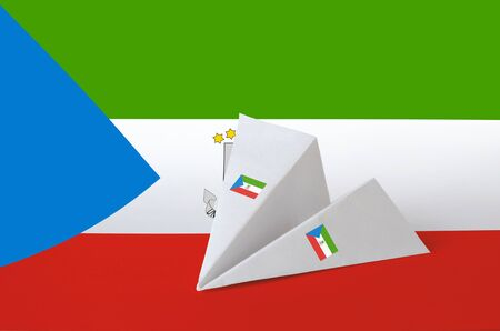Equatorial Guinea flag depicted on paper origami airplane. Oriental handmade arts concept
