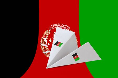 Afghanistan flag depicted on paper origami airplane. Oriental handmade arts concept