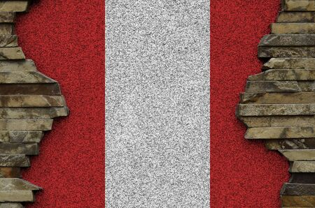 Peru flag depicted in paint colors on old stone wall close up. Textured banner on rock wall background Stock Photo