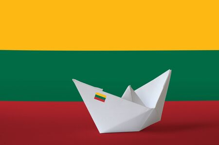 Lithuania flag depicted on paper origami ship closeup. Oriental handmade arts concept Stock fotó