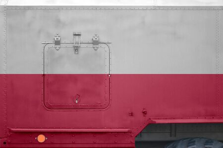 Poland flag depicted on side part of military armored truck close up. Army forces vehicle conceptual background 스톡 콘텐츠
