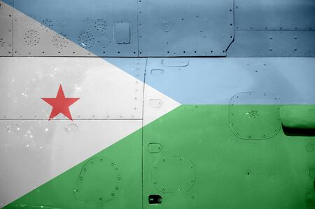 Djibouti flag depicted on side part of military armored helicopter close up. Army forces aircraft conceptual background