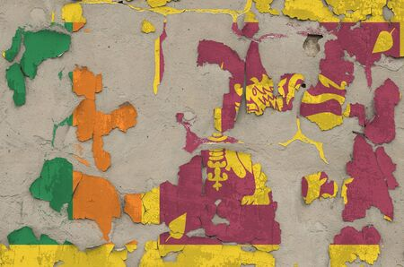 Sri Lanka flag depicted in paint colors on old obsolete messy concrete wall close up. Textured banner on rough background