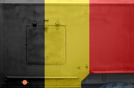 Belgium flag depicted on side part of military armored truck close up. Army forces vehicle conceptual background 스톡 콘텐츠