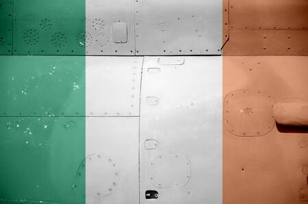 Ireland flag depicted on side part of military armored helicopter close up. Army forces aircraft conceptual background