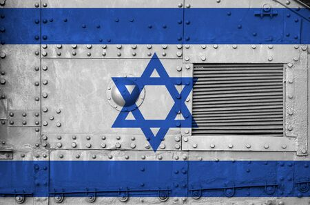 Israel flag depicted on side part of military armored tank close up. Army forces conceptual background