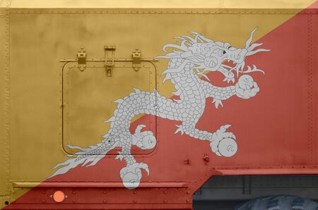 Bhutan flag depicted on side part of military armored truck close up. Army forces vehicle conceptual background