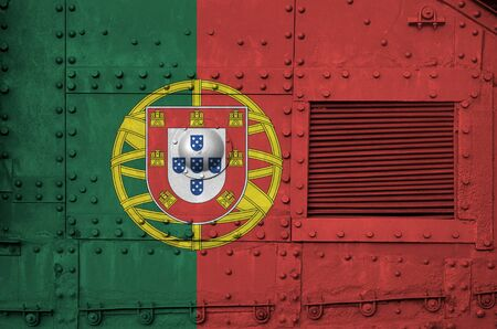 Portugal flag depicted on side part of military armored tank close up. Army forces conceptual background 스톡 콘텐츠