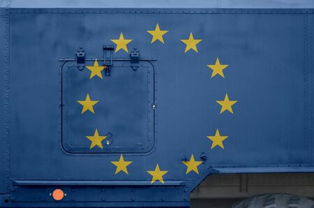 European union flag depicted on side part of military armored truck close up. Army forces vehicle conceptual background 스톡 콘텐츠