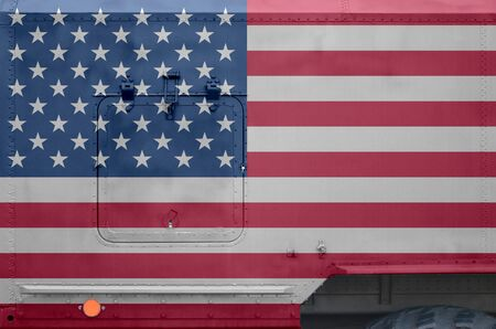 United States of America flag depicted on side part of military armored truck close up. Army forces vehicle conceptual background