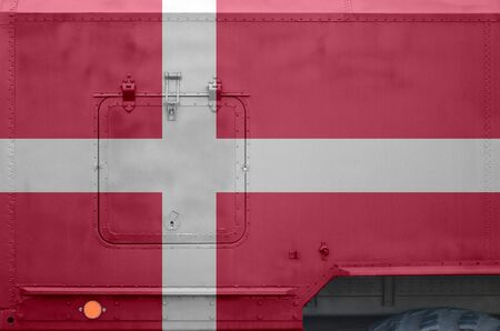 Denmark flag depicted on side part of military armored truck close up. Army forces vehicle conceptual background 스톡 콘텐츠