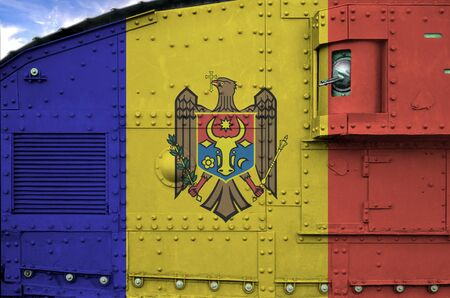 Moldova flag depicted on side part of military armored tank close up. Army forces conceptual background 스톡 콘텐츠