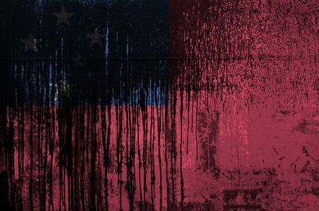 Samoa flag depicted in paint colors on old and dirty oil barrel wall close up. Textured banner on rough background