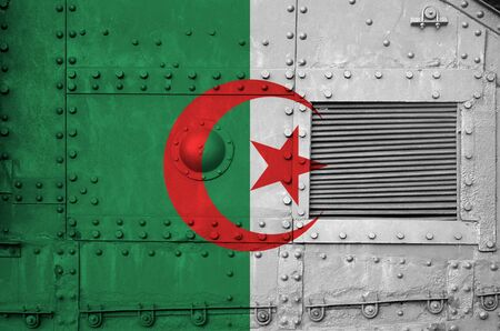 Algeria flag depicted on side part of military armored tank close up. Army forces conceptual background