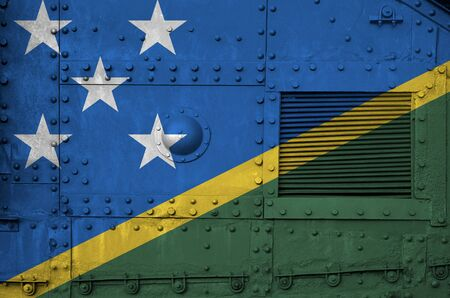 Solomon Islands flag depicted on side part of military armored tank close up. Army forces conceptual background