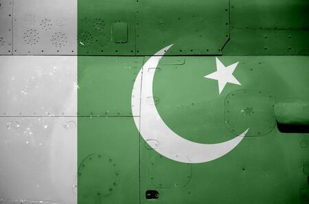 Pakistan flag depicted on side part of military armored helicopter close up. Army forces aircraft conceptual background