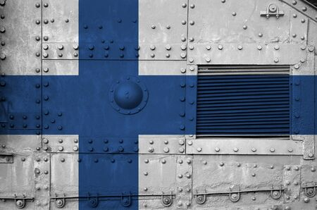 Finland flag depicted on side part of military armored tank close up. Army forces conceptual background