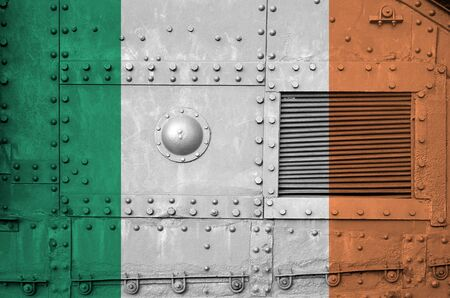 Ireland flag depicted on side part of military armored tank close up. Army forces conceptual background