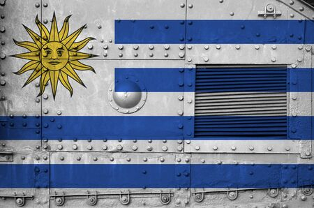 Uruguay flag depicted on side part of military armored tank close up. Army forces conceptual background