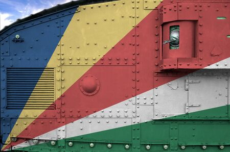 Seychelles flag depicted on side part of military armored tank close up. Army forces conceptual background