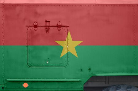 Burkina Faso flag depicted on side part of military armored truck close up. Army forces vehicle conceptual background