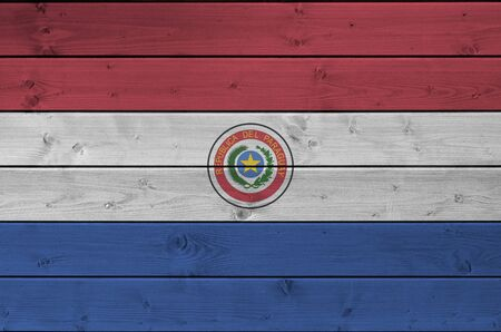 Paraguay flag depicted in bright paint colors on old wooden wall close up. Textured banner on rough background Reklamní fotografie