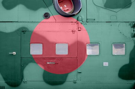 Bangladesh flag depicted on side part of military armored helicopter close up. Army forces aircraft conceptual background