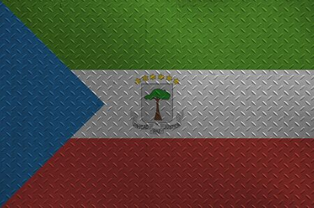 Equatorial Guinea flag depicted in paint colors on old brushed metal plate or wall close up. Textured banner on rough background