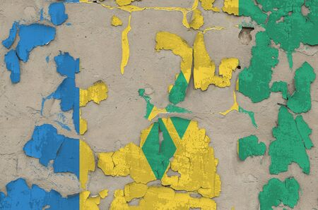 Saint Vincent and the Grenadines flag depicted in paint colors on old obsolete messy concrete wall close up. Textured banner on rough background 写真素材