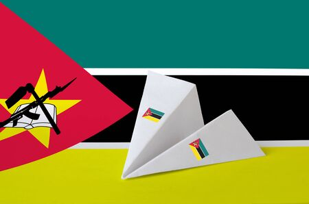 Mozambique flag depicted on paper origami airplane. Oriental handmade arts concept Stock fotó