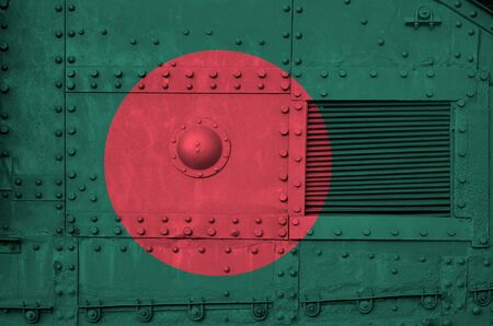 Bangladesh flag depicted on side part of military armored tank close up. Army forces conceptual background