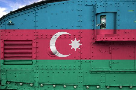 Azerbaijan flag depicted on side part of military armored tank close up. Army forces conceptual background