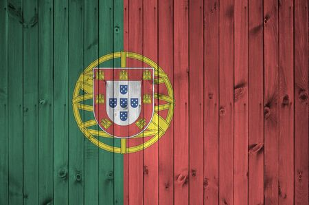 Portugal flag depicted in bright paint colors on old wooden wall close up. Textured banner on rough background Banque d'images
