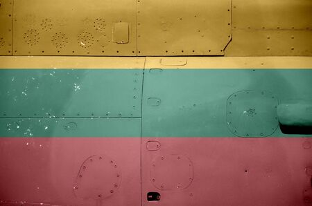 Lithuania flag depicted on side part of military armored helicopter close up. Army forces aircraft conceptual background