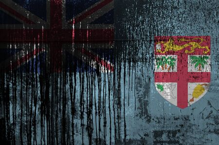 Fiji flag depicted in paint colors on old and dirty oil barrel wall close up. Textured banner on rough background Stock fotó