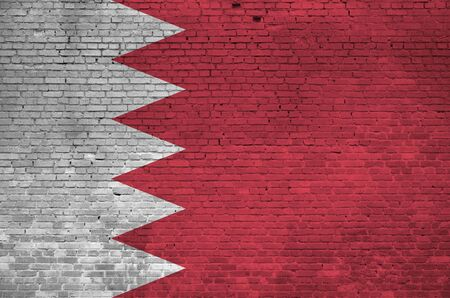 Bahrain flag depicted in paint colors on old brick wall close up. Textured banner on big brick wall masonry background Reklamní fotografie