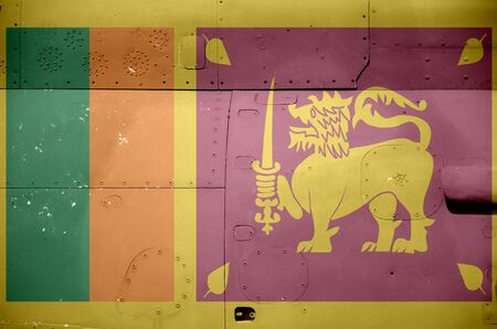 Sri Lanka flag depicted on side part of military armored helicopter close up. Army forces aircraft conceptual background