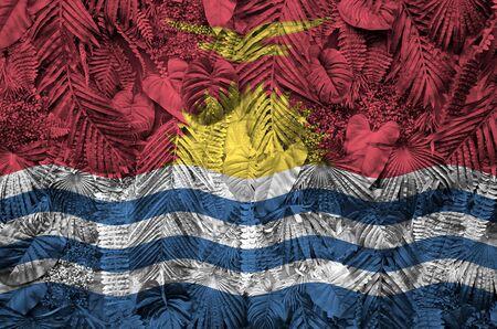 Kiribati flag depicted on many leafs of monstera palm trees. Trendy fashionable background