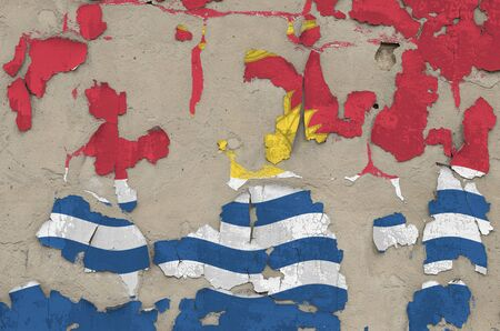 Kiribati flag depicted in paint colors on old obsolete messy concrete wall close up. Textured banner on rough background