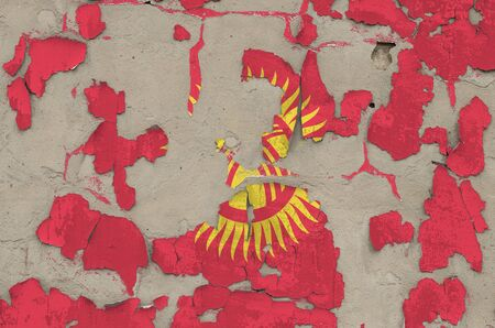 Kyrgyzstan flag depicted in paint colors on old obsolete messy concrete wall close up. Textured banner on rough background