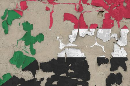 Sudan flag depicted in paint colors on old obsolete messy concrete wall close up. Textured banner on rough background 写真素材