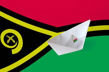 Vanuatu flag depicted on paper origami ship closeup. Oriental handmade arts concept