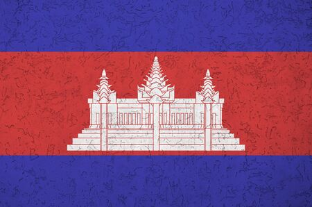 Cambodia flag depicted in bright paint colors on old relief plastering wall close up. Textured banner on rough background Reklamní fotografie