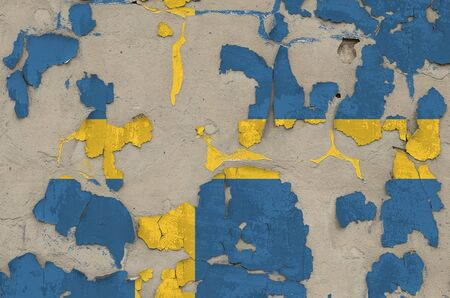 Sweden flag depicted in paint colors on old obsolete messy concrete wall close up. Textured banner on rough background