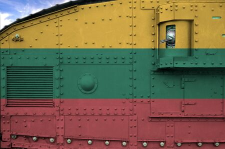 Lithuania flag depicted on side part of military armored tank close up. Army forces conceptual background Reklamní fotografie