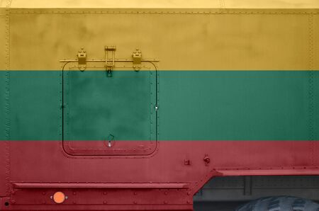 Lithuania flag depicted on side part of military armored truck close up. Army forces vehicle conceptual background