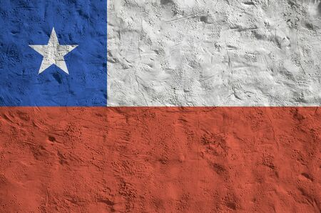 Chile flag depicted in bright paint colors on old relief plastering wall close up. Textured banner on rough background