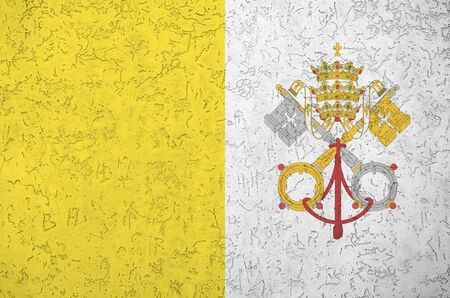 Vatican City State flag depicted in bright paint colors on old relief plastering wall close up. Textured banner on rough background