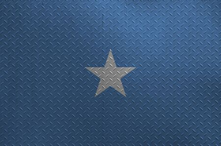 Somalia flag depicted in paint colors on old brushed metal plate or wall close up. Textured banner on rough background Stockfoto
